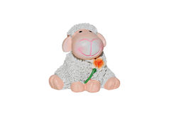 Toy lamb with flower. Toy Lamb on White Background. The symbol of the new year royalty free stock image