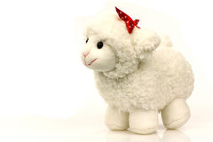Toy lamb with a ribbon. On a white background stock photo
