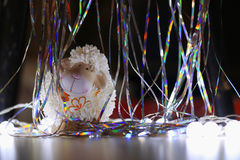 Toy lamb and shiny serpentine. Toy lamb with shiny serpentine royalty free stock image