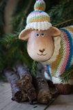 Toy lamb. And spruce branches royalty free stock photo