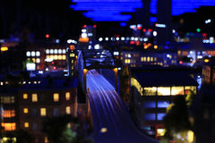 Toy layout illuminated night city. The night view of the lighted city Royalty Free Stock Photo
