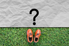 Toy leather shoe on grass field texture background.jpg Stock Photos