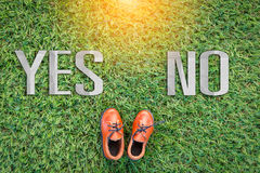 Toy leather shoe on grass field texture background  think about Stock Photography