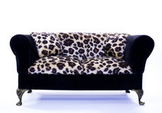 Toy leopard fur couch. A toy leopard fur couch isolated on white Stock Photos