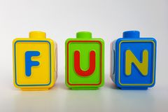 Toy letter blocks that spell FUN. In front of a white background Stock Photos
