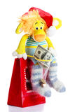 Toy lion as christmas gift on Santa Claus cap Royalty Free Stock Images