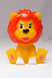 Toy lion sits Royalty Free Stock Photography