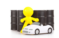 Toy  little man against butts with oil Stock Image