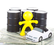 Toy  little man against butts with oil Royalty Free Stock Image