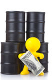 Toy little man costs at butts with oil and royalty free stock images