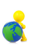 Toy little man rolls forward globe. It is , a white background Stock Photo