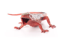 Toy Lizard/Dinosaur. Red lizard toy isolated on white background Royalty Free Stock Photo
