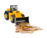 Toy loader and money coins Royalty Free Stock Photos