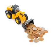 Toy loader and money coins Royalty Free Stock Photo