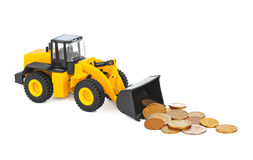Toy loader and money coins Royalty Free Stock Images