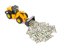 Toy loader and money Stock Photos