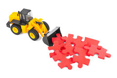 Toy loader with puzzle Stock Photography