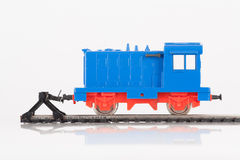 Toy locomotive and buffer. Pictured items of a toy railroad Stock Photo