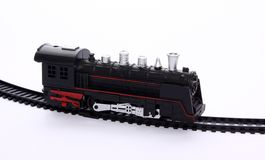 Toy locomotive on the railroad tracks royalty free stock photography