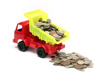 Toy lorry with coins Stock Images