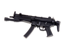 Toy machine gun. Plastic toy special forces machine gun isolated over white Stock Photography
