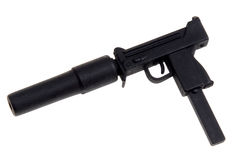 Toy machine gun. Plastic toy special forces machine gun with a silencer isolated over white Stock Image
