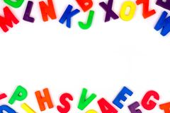 Toy magnetic alphabet letter double border over white Royalty Free Stock Photo
