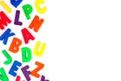 Toy magnetic alphabet letter side border over white Royalty Free Stock Photography