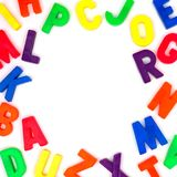 Toy magnetic alphabet letter square frame over white Stock Image