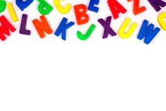 Toy magnetic alphabet letter top border over white Stock Photo