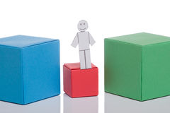 Toy man on red box Stock Photos