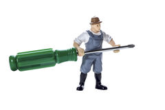 Toy man with screwdriver royalty free stock images