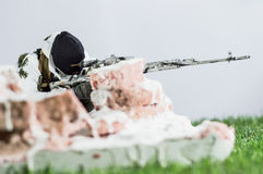 Toy man soldier action figure miniature realistic silk. Snow spetsnaz sniper crouch in aim Royalty Free Stock Photo