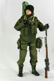 Toy man soldier action figure miniature realistic silk white background Stock Photography