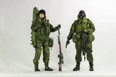 Toy man soldier action figure miniature realistic silk white background Royalty Free Stock Image