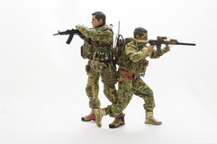 Toy man soldier action figure white background. On the scale miniature realistic toy soldiers helping friends Stock Image