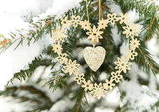 Toy metal heart on the twig of fir-tree. Royalty Free Stock Photo