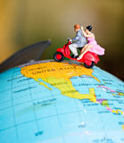 Toy miniature figures of a couple traveling on a Vespa Stock Photos