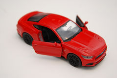 Toy miniature red car Royalty Free Stock Photos