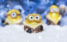 Toy minions in snow. MAGNITOGORSK, RUSSIA - September 05, 2016: Toy minions in the artificial snow. Minions are the creatures that appear in the `Despicable Me` royalty free stock photography