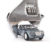 Toy model car wedged Royalty Free Stock Photo