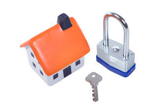 Toy model house with padlock and key Royalty Free Stock Photo