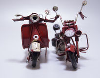A toy model of a motocycle and a scooter. Close up. Stock Image