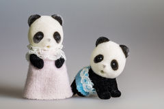 Toy mom and baby panda. With skirt royalty free stock image