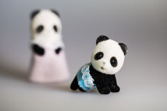 Toy mom and baby panda. With skirt stock photo