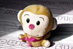 A toy monkey. A cute toy monkey on the bed Stock Photo