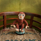 Toy monkey in the arena Royalty Free Stock Photography
