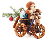 Toy monkey on a bicycle. Stock Photo