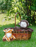 Toy monkey and giraffe in a basket Royalty Free Stock Photography