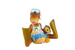 Toy Monkey mit Flippern und Maske im Erholungsort Lizenzfreies Stockfoto